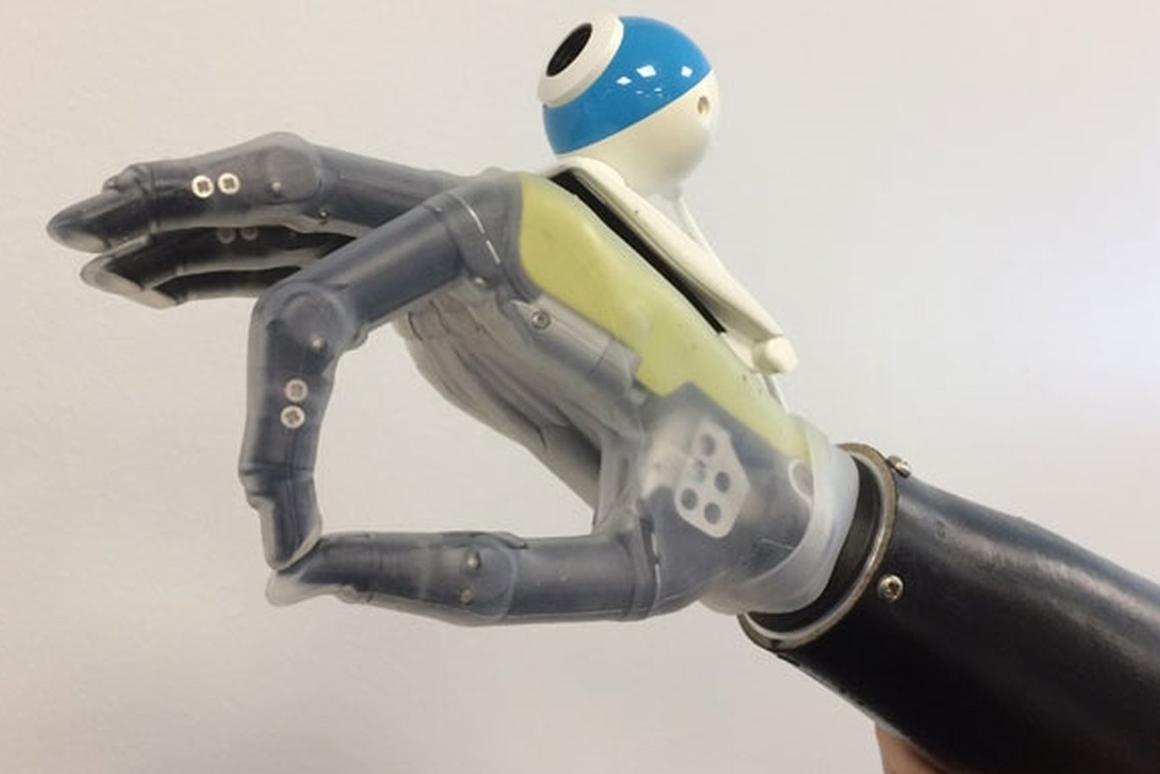 The prototype hand uses an off-the-shelf digital camera to help reach for and grasp objects