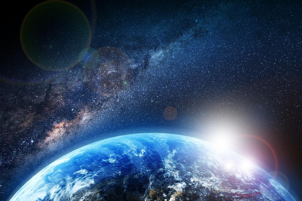 New calculations show the Earth is 25,800 light-years from galactic center and traveling at 227 km/s