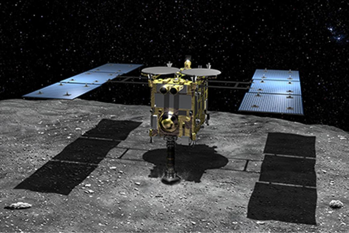 Artist's concept of Haybusa2 taking a surface sample on JU3 (Image: JAXA)