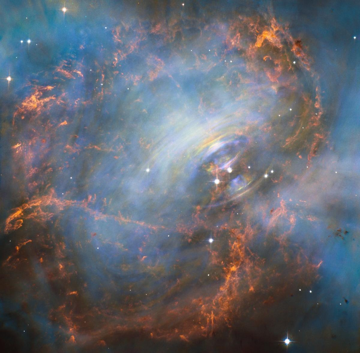 View of the Crab Nebula made up of three separate Hubble images