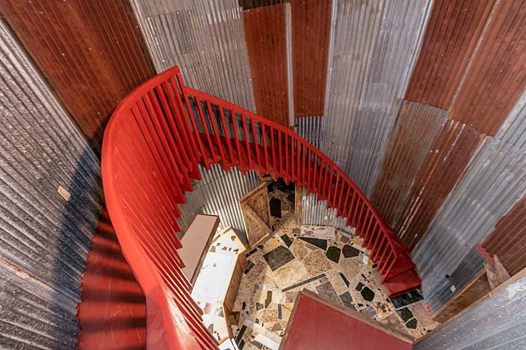 The Cowboy Boot House features an impressive-looking spiral staircase that leads to a rooftop deck