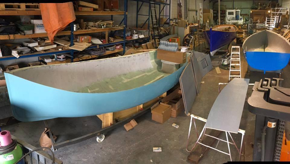 Plastic waste from Amsterdam's canals is transformed into boats that Plastic Whale takes out to collect more trash