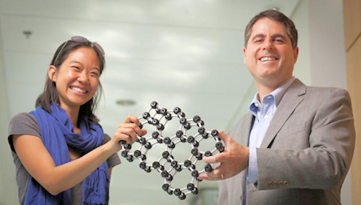 Cornell professor David Muller and grad student Pinshane Huang show a model of the atomic structure of the world's thinnest glass (Photo: Cornell University)