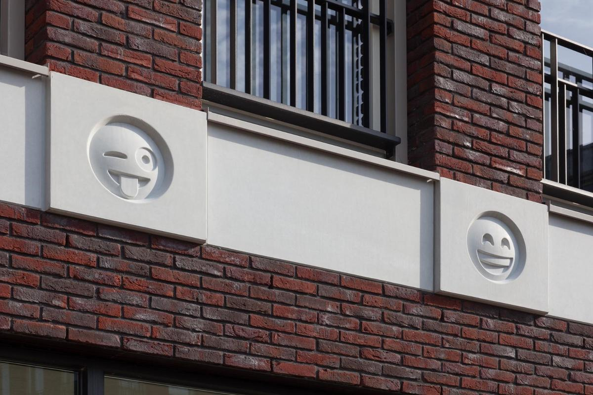 The emoji look a lot better than you'd expect them to, in large part because the architects didn't paint them