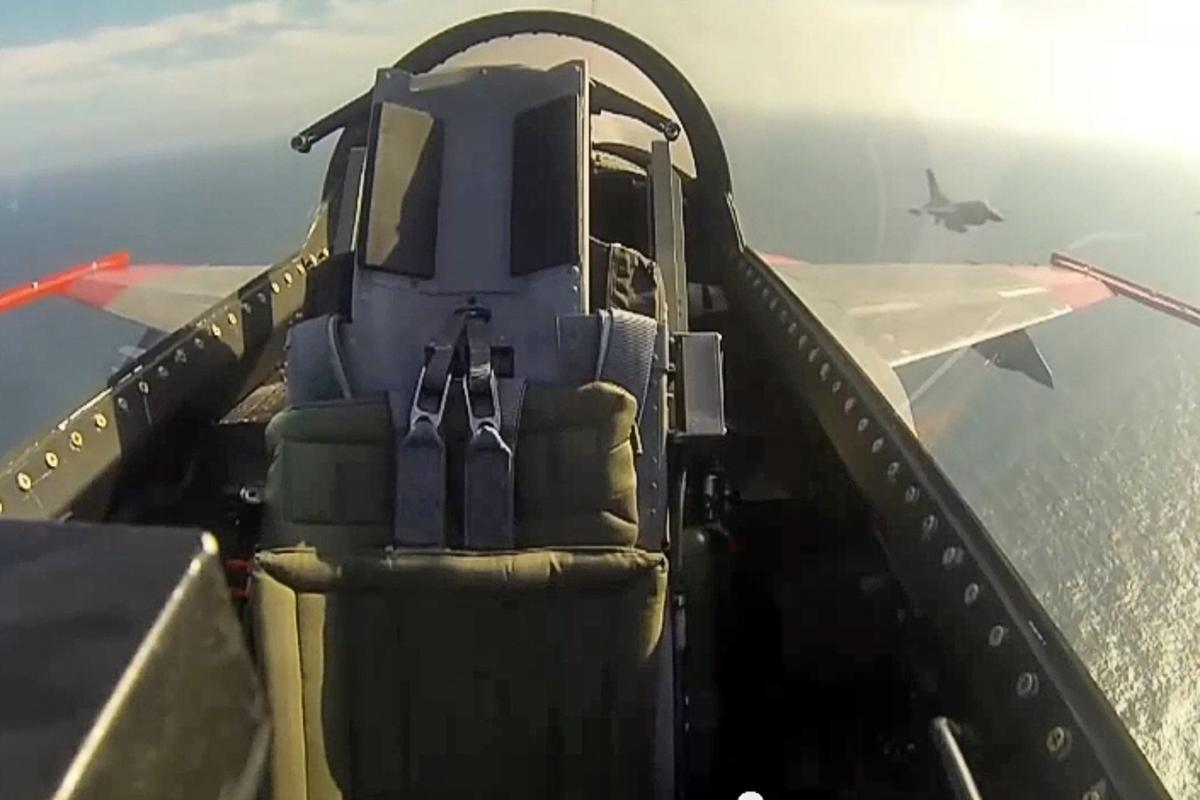 Unmanned F-16 fighter jet going through combat maneuvers in the Gulf of Mexico