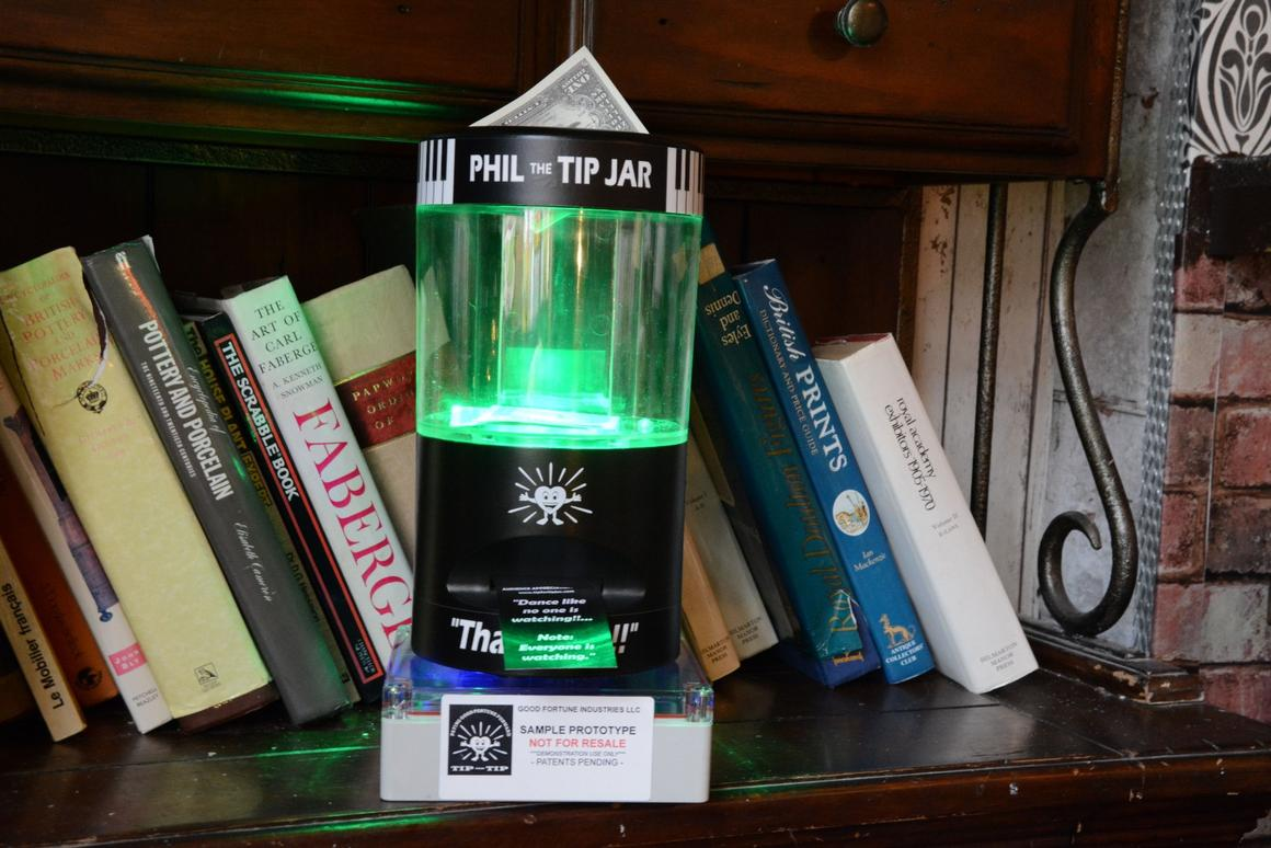 A battery-powered Phil the Tip Jar waits patiently for loose change or notes to be dropped in its money slot