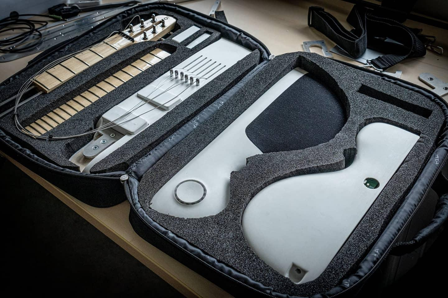The Slite travel guitar breaks down into five parts for transport in a case about the same size as a laptop bag