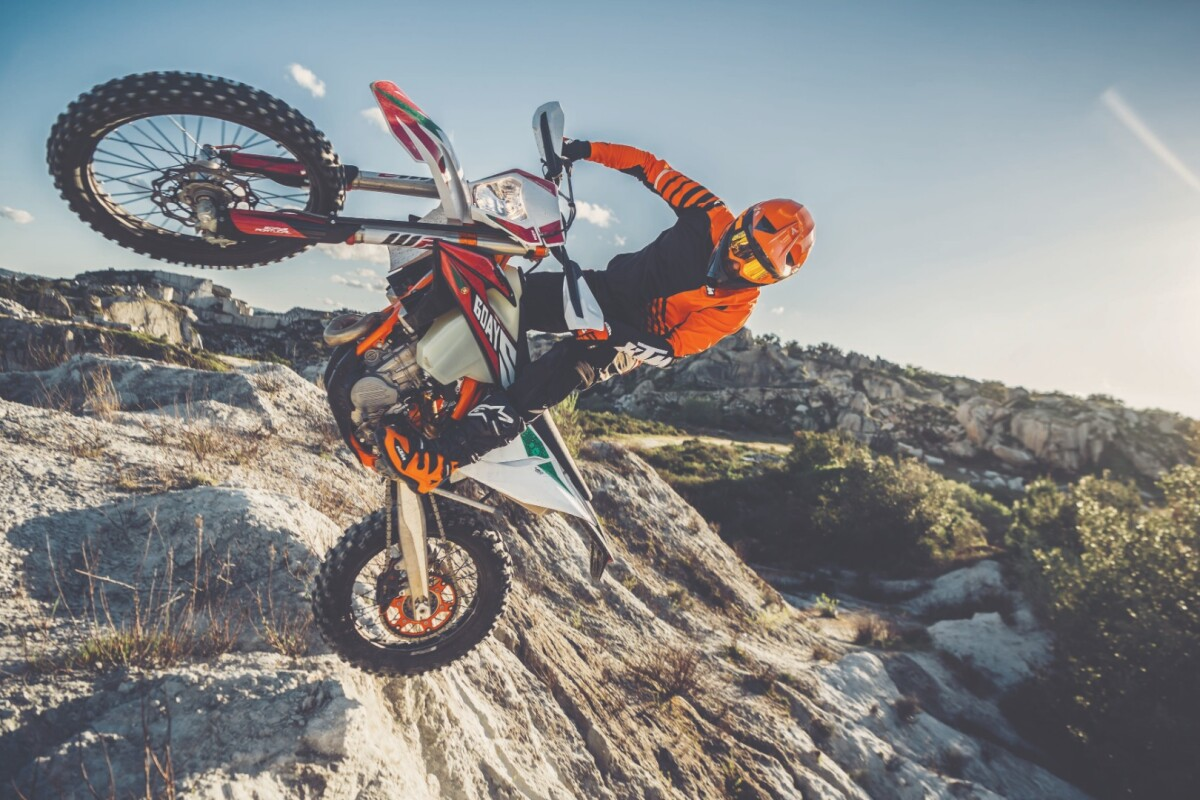 The 2020 KTM 450 EXC-F (Six Days edition) at an improbable angle. If you or I found ourselves at this angle, hospital would soon follow