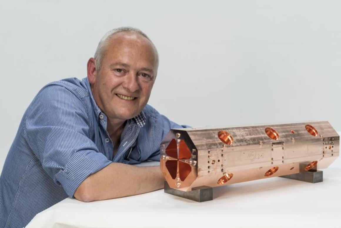 Serge Mathot with the first of the four modules that will make up the miniature accelerator