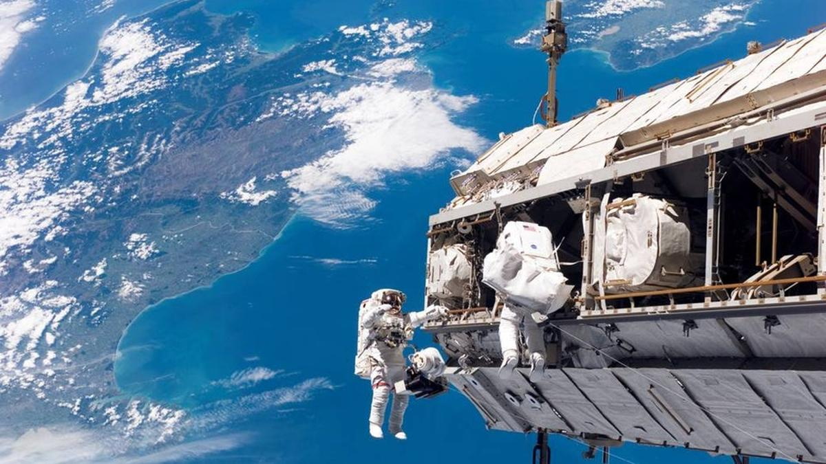 Astronauts toiling away on the International Space Station during an earlier spacewalk