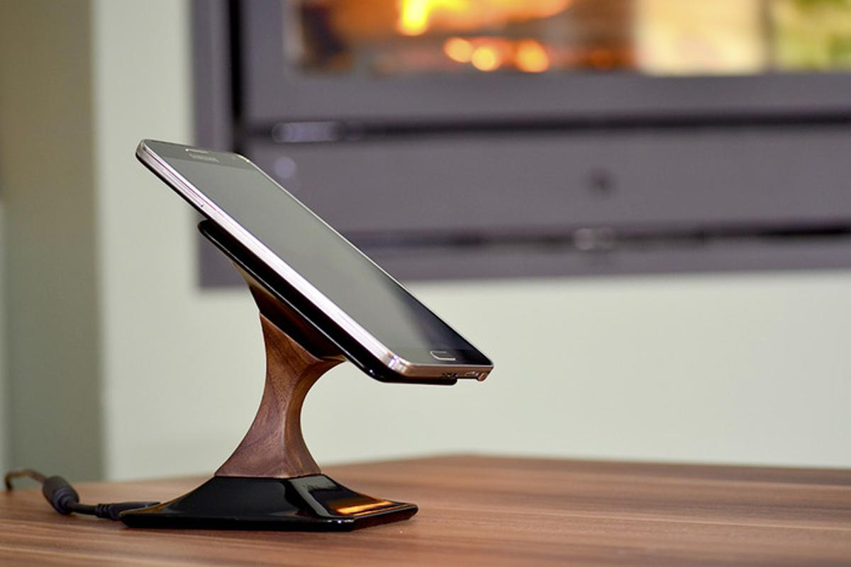 Made from ceramic and American Walnut, Swich uses micro-suction caps to hold your phone in place while it charges