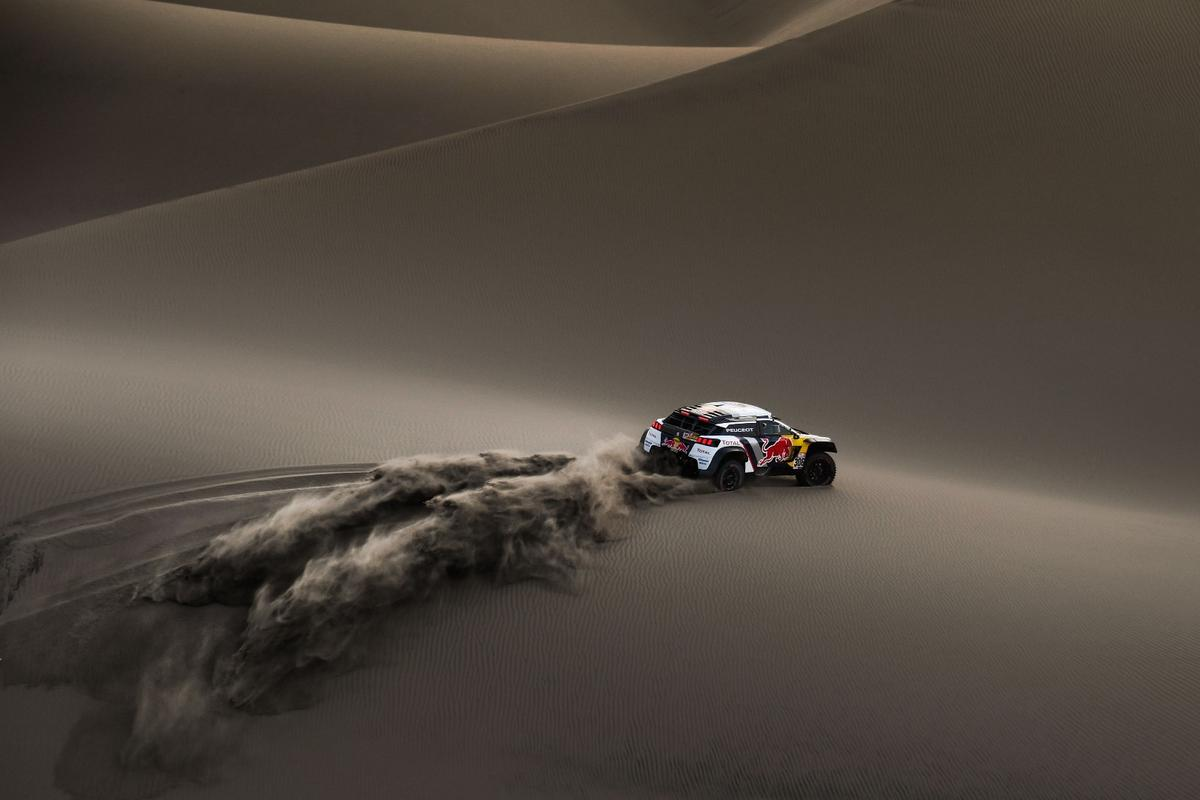Loeb and Elena's Peugeot carves a fresh path through surreal sand dunes on the 2018 Dakar Rally