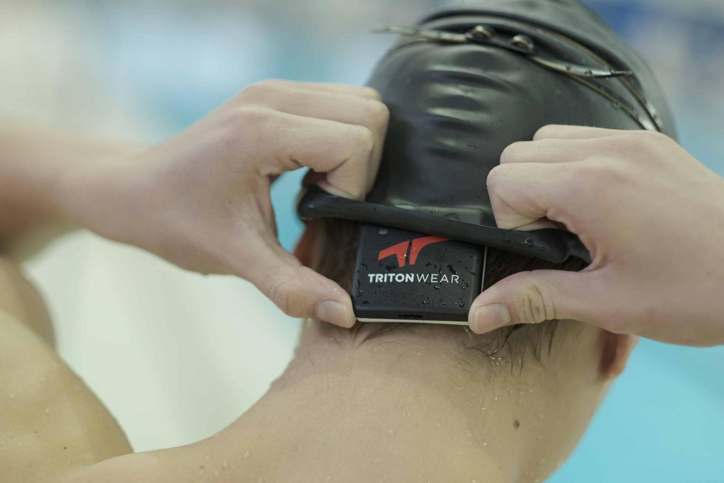 The Triton 2 is placed beneath the swimmer's cap, and transmits data to a coach's mobile device