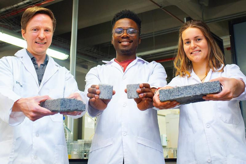 Dr Dyllon Randall, left, supervised the research leading to the bricks made with human urine