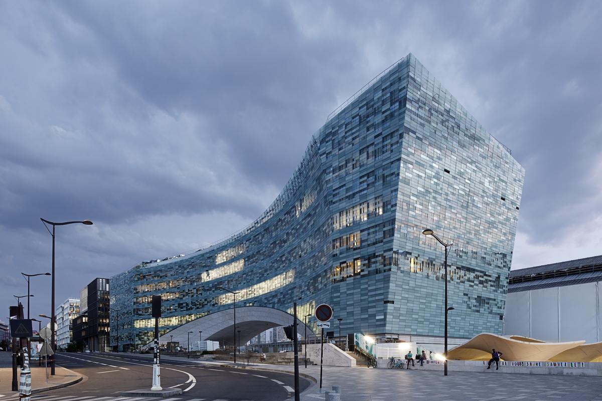 The new Le Monde headquarters' pixelated glass facade consists of 20,000 pieces of glass