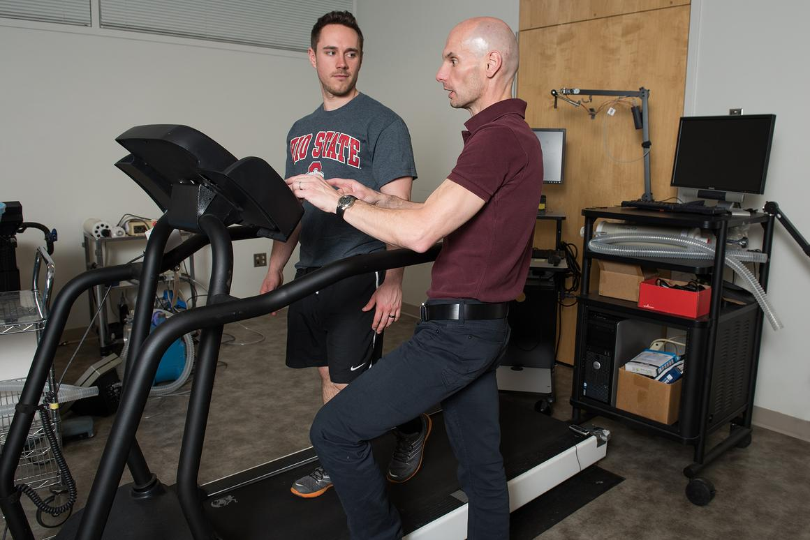 Steven Devor (right) discusses the automated treadmill with doctoral student Rich LaFountain (Photo: Jo McCulty/The Ohio State University)