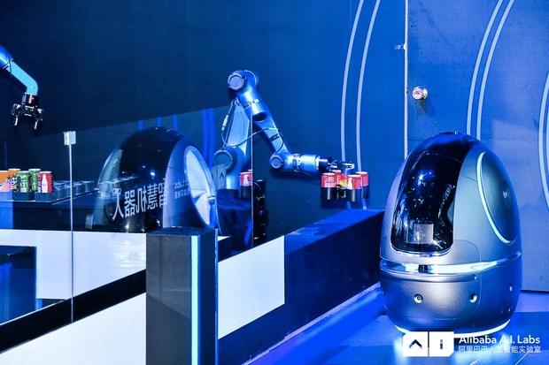 The robot will pick up requested items from either a human staff member or a robotic dispensing system