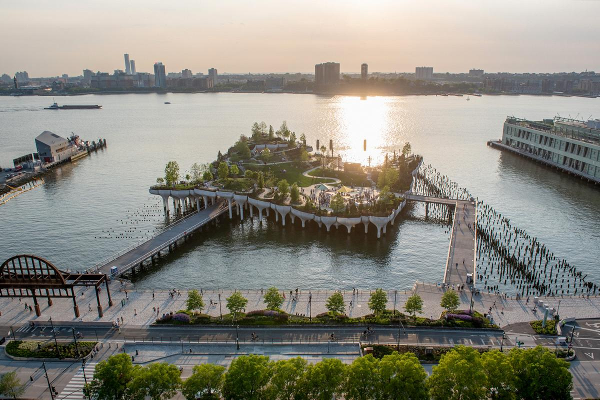 Little Island's design is inspired by a former dilapidated pier that existed on the site and many of its wooden supports have been retained