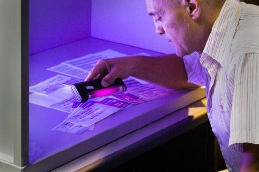 Xerox demonstrates its flourescent anti-counterfeit technology.