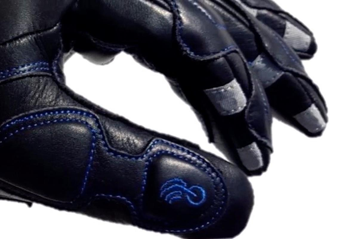 BearTek II gloves feature six touchpoints (seen in grey) that perform separate functions
