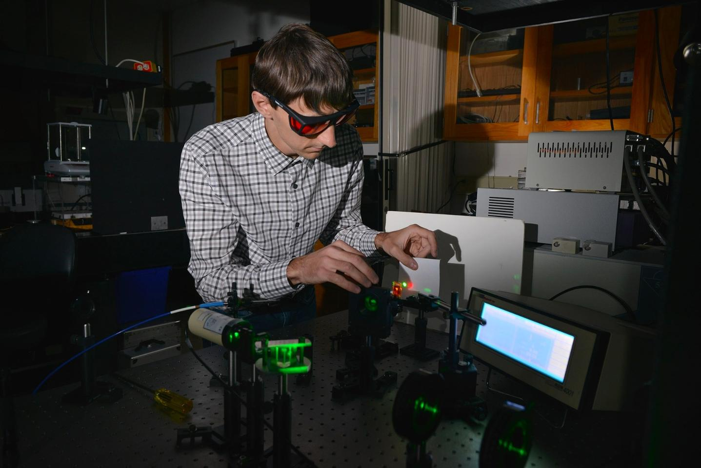 Kent State University chemical physics graduate student Andrii Varanytsia demonstrates laser emission with a liquid crystal elastomer