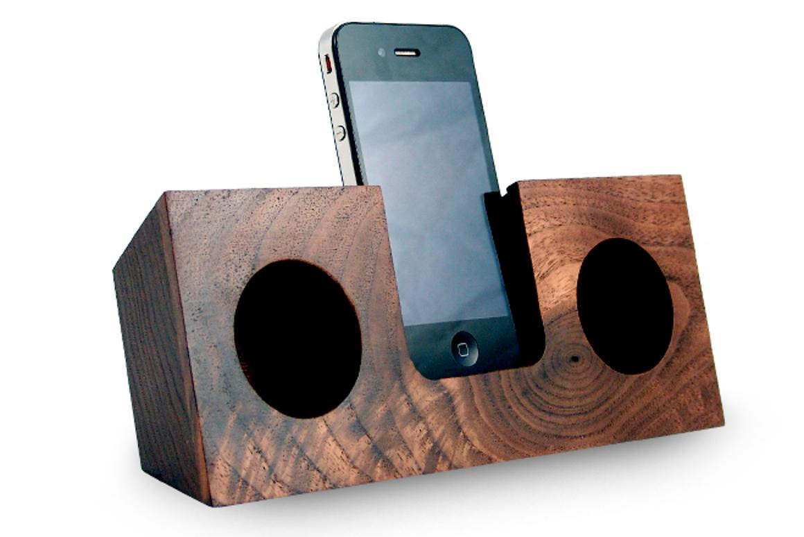 The Koostik iPhone dock utilizes the smartphone's own speakers, and channels the audio into hollowed out, hemispherical sound chambers where the sound is amplified by up to four times
