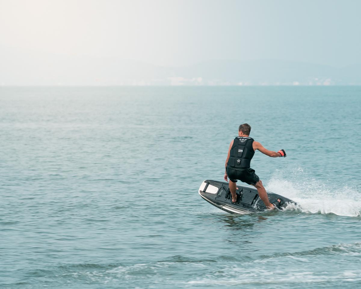 A redesigned hull allows surfers to dig into the water for tighter carving