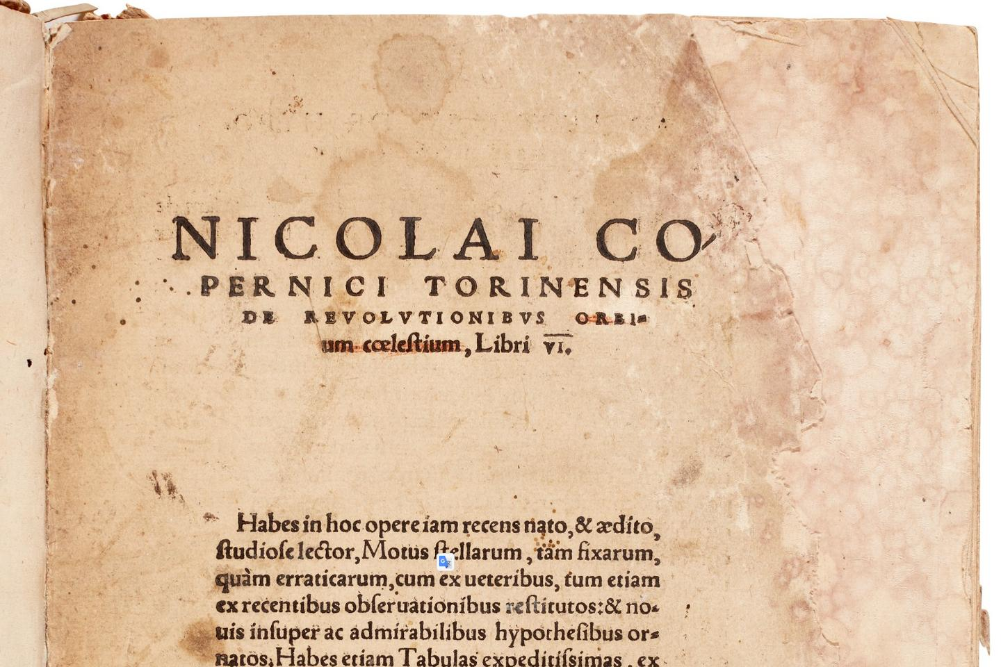 """The title page of this first edition copy of Nicolas Copernicus' De revolutionibus orbium coelestium has the words """"orbium coelestium"""" crossed out in red. It is believed these markings were made by the hand of Rheticus."""