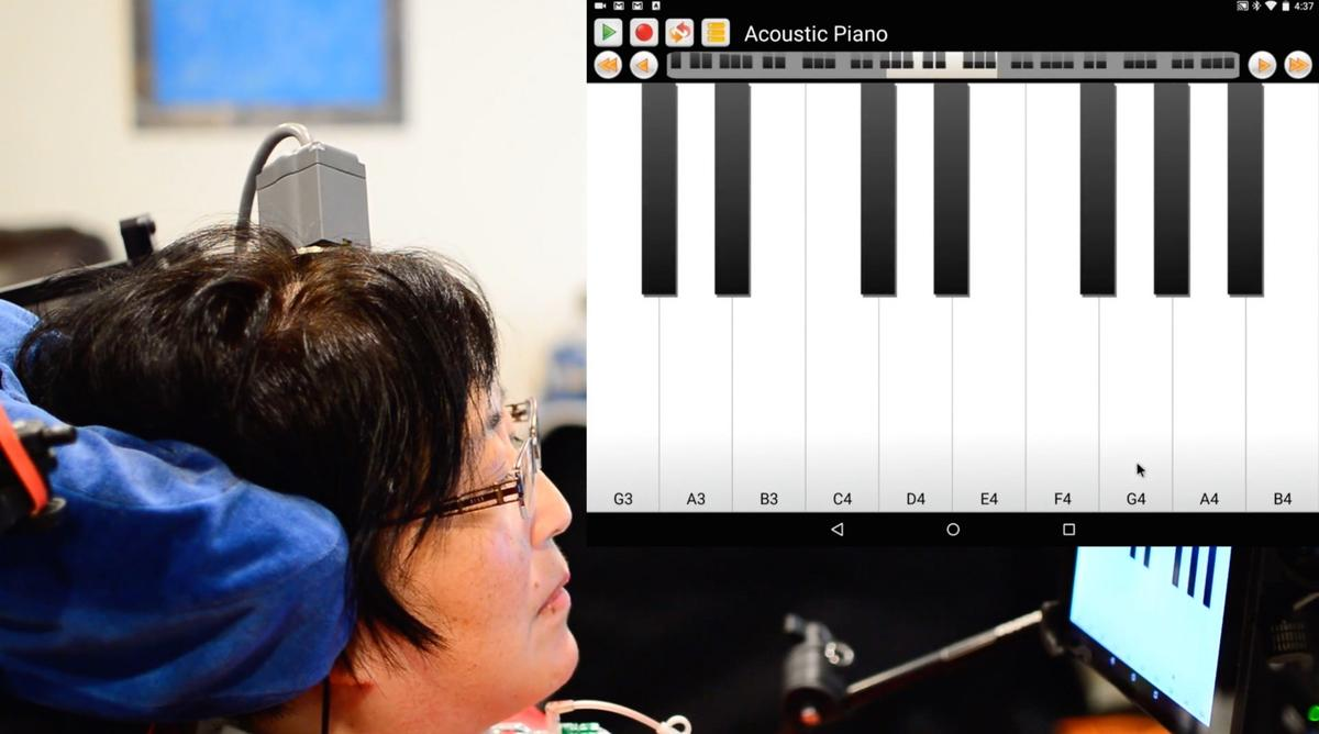 """A test subjectuses the BrainGate BCI toplay""""Ode to Joy"""" on a virtual keyboard interface"""