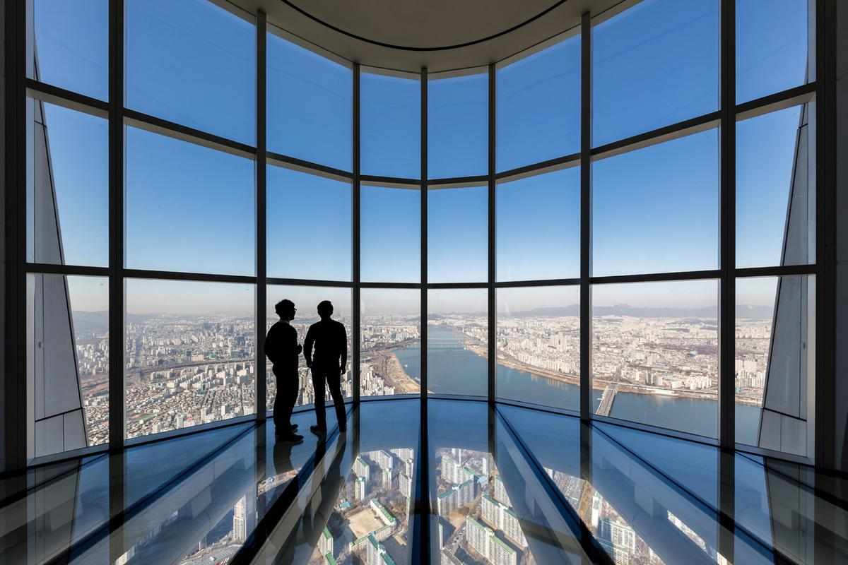 The Lotte World Tower's glass-bottomed observation deck – the world's tallest at a height of 497.6 m (1,633 ft) – is reached by the world's fastest elevator
