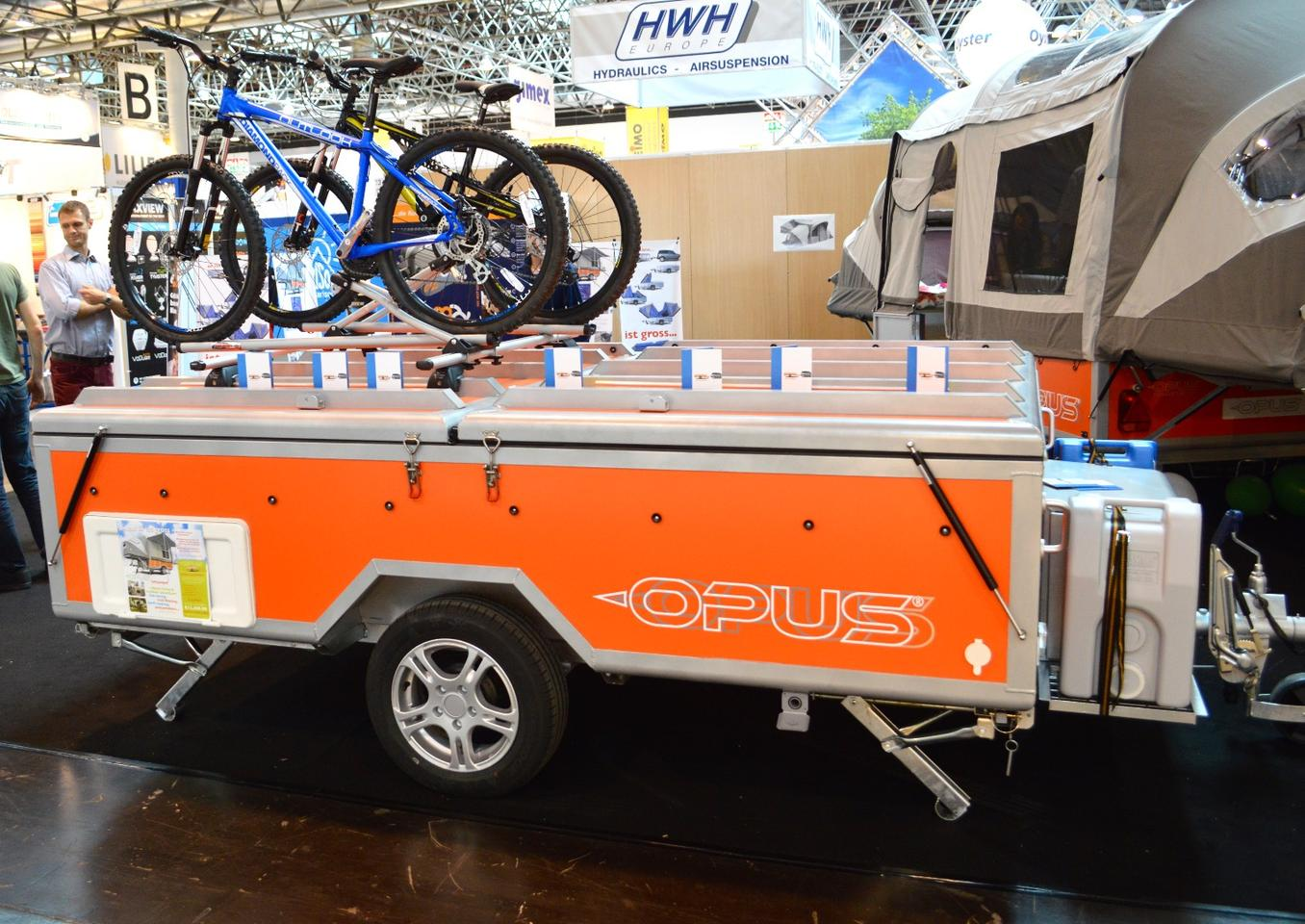 Shown here at the 2013 Düsseldorf Caravan Salon, the original Opus was prepared to haul bikes or kayaks, but not motorcycles