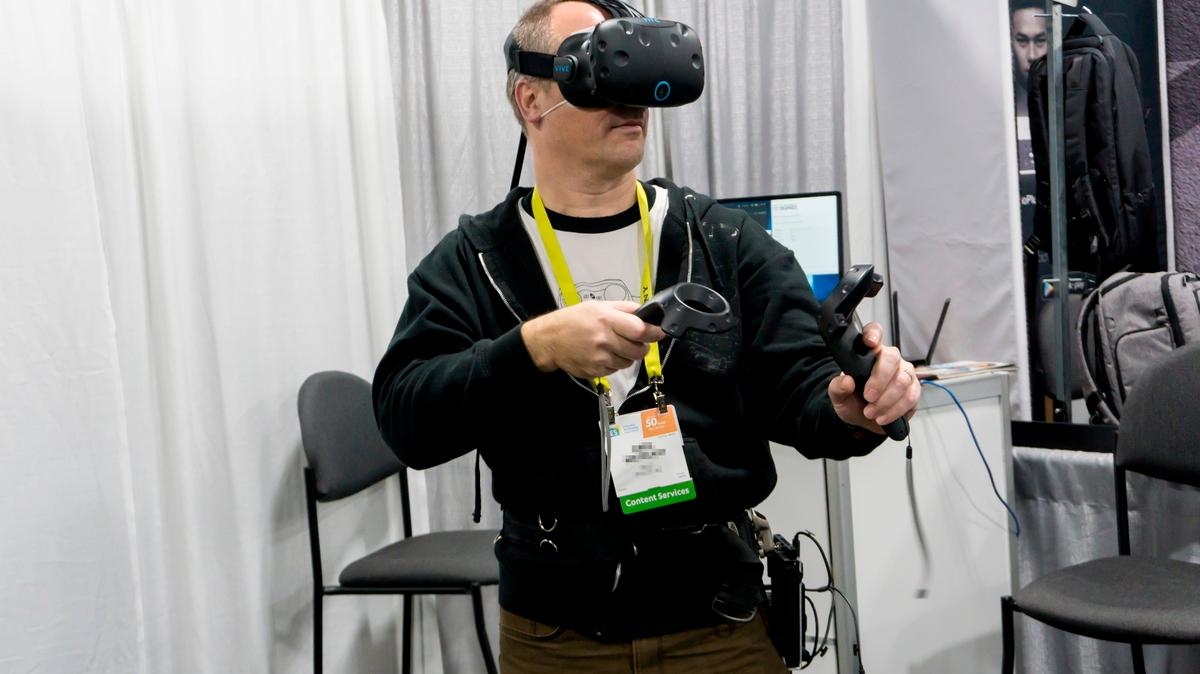 A CES attendee demoing KwikVR's wireless adapter for the HTCVive and Oculus Rift