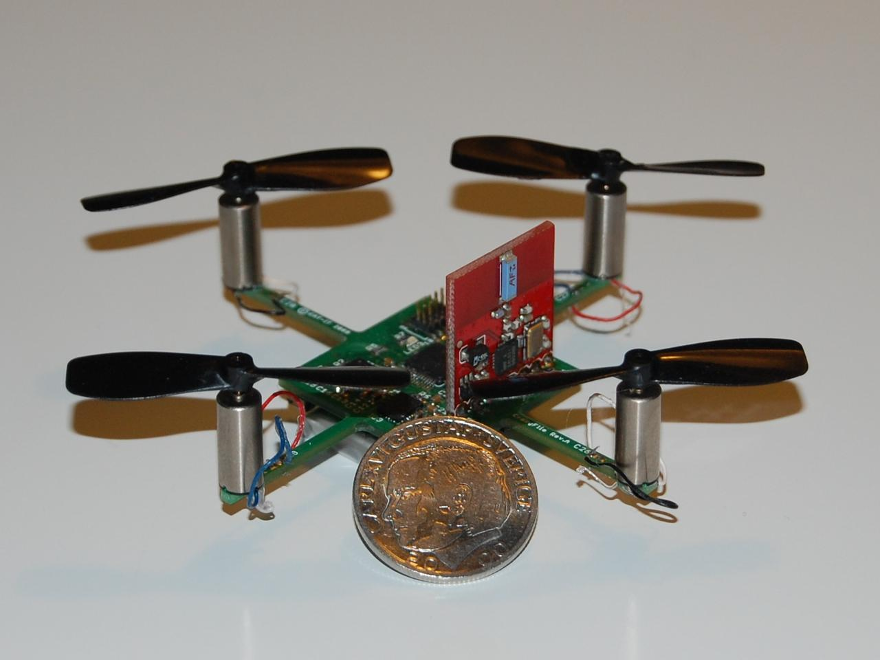 The first prototype Crazyflie quadcopters featured a main board with a 2.4 GHz radio sticking up