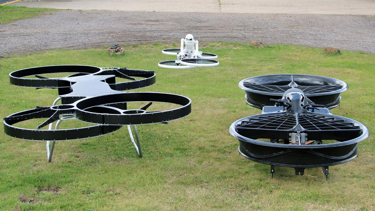 From left to right: the second prototype Hoverbike, the drone (in flight), and the original dual-rotor prototype (Photo: Chris Wood/Gizmag)