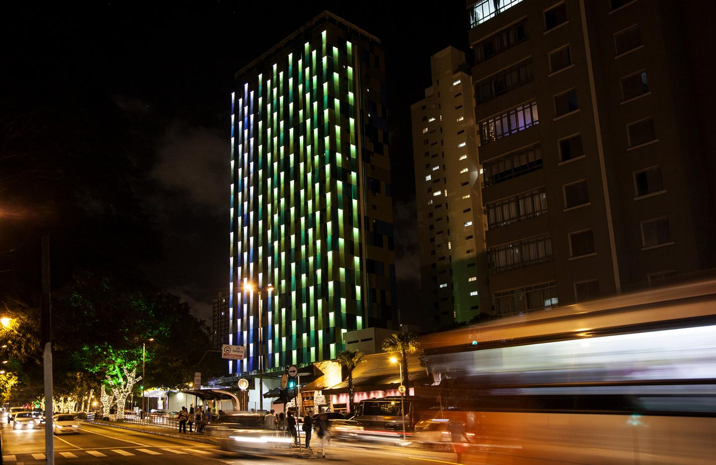 The façade comprises a 30-story pixelated sheet of metal