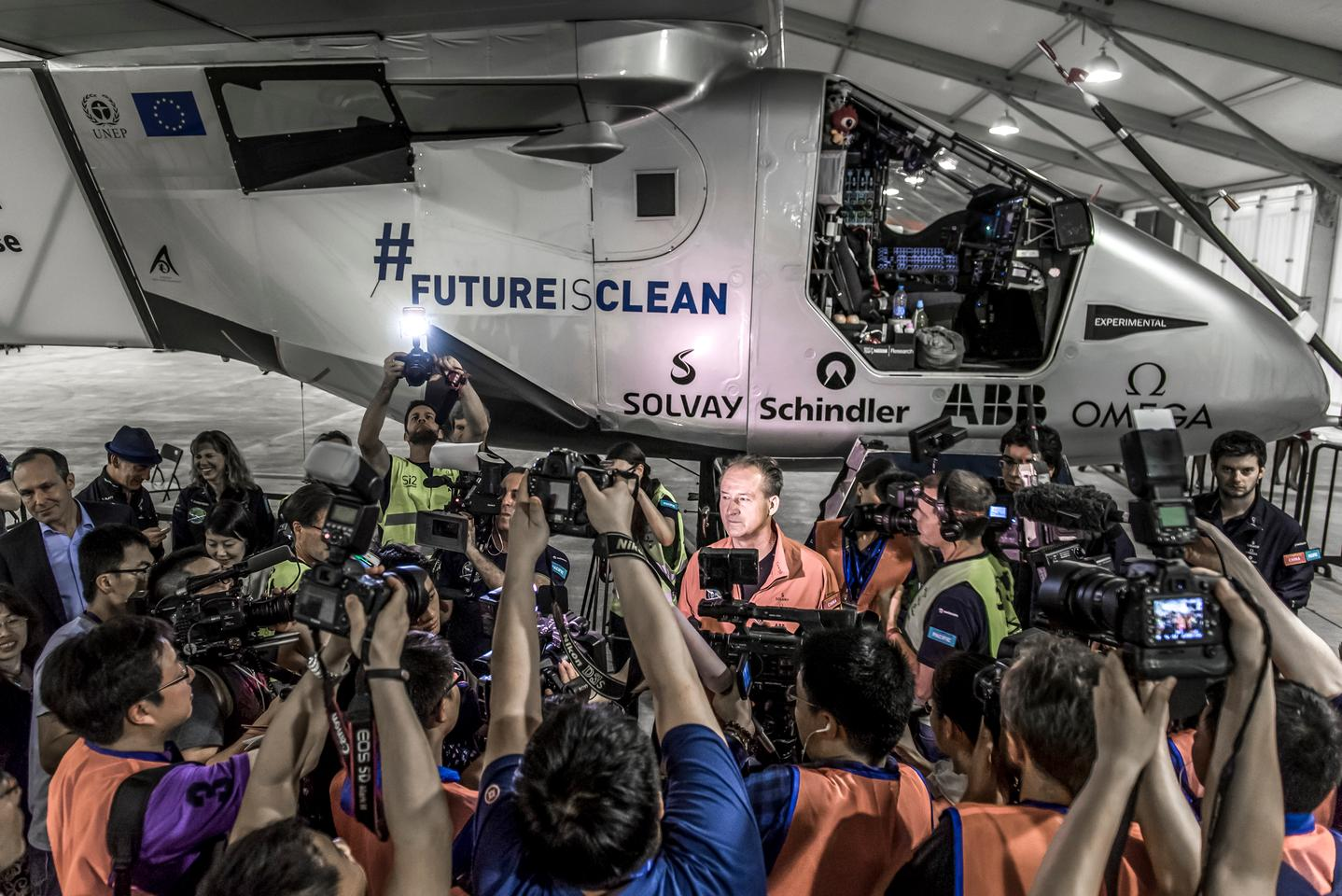 André Borschberg in front of the media before boarding Solar Impulse 2 to attempt the first oceanic flight of the world journey