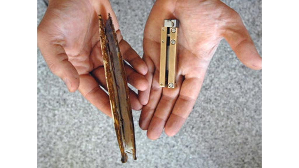 The RoboClam (right) and the razor clam which provided the inspiration for its design