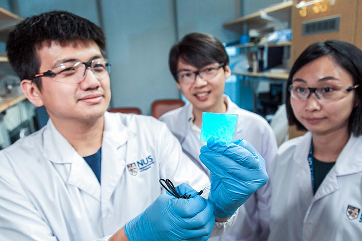 Asst. Prof. Benjamin Tee (center), with team members Mr. Wang Guanxiang (left) and Dr. Tan Yu Jun (right)