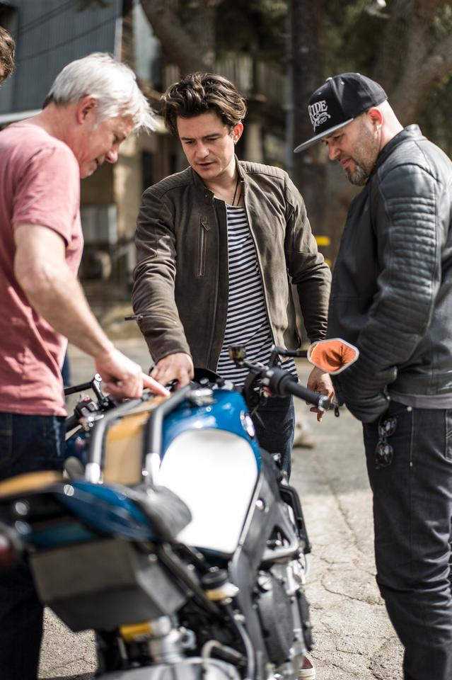 Movie star Orlando Bloom, custom builder Michael Woolaway and BMW designer Ola Stenegard inspect the 4CYL
