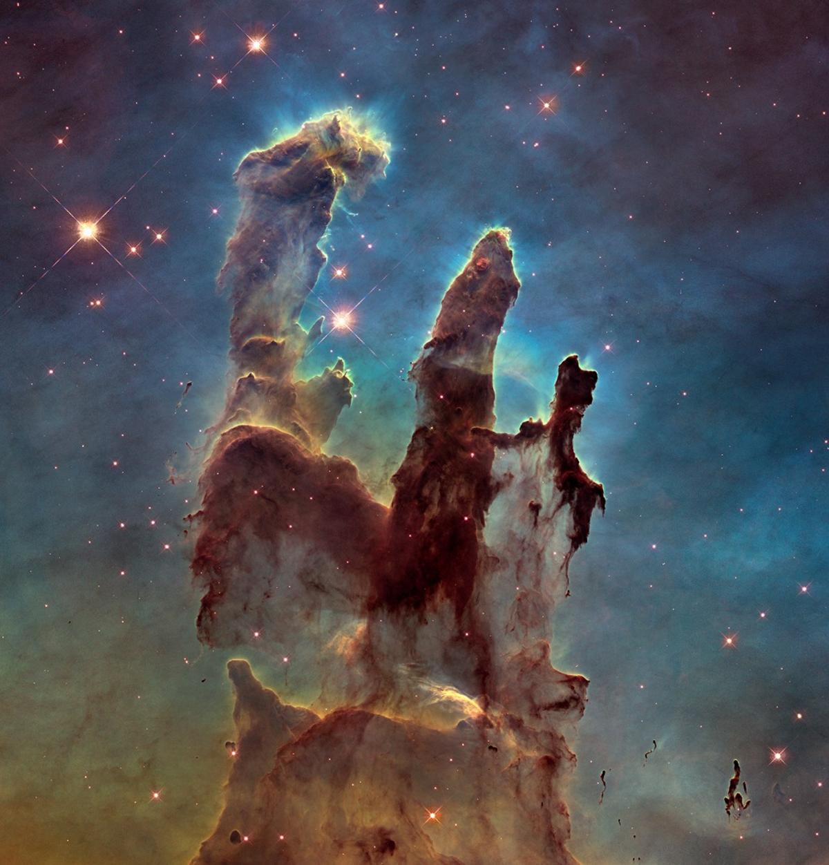 The so-called Pillars of Creation, snapped hereby Hubble, is stewing with life-givingorganic molecules like those that were recently created under space conditions in the lab