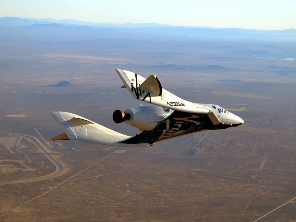 SpaceShipTwo's first glide in powered flight configuration with the rocket motor nozzle visible