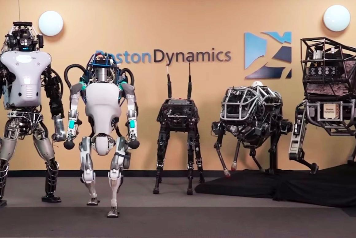 The latest Atlas robot (second from left) has joined Boston Dynamics' robotic family
