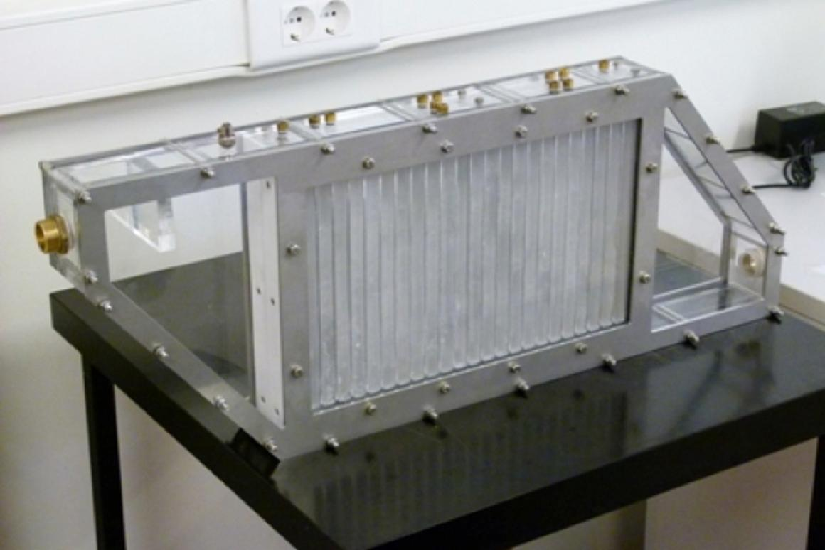 The prototype device utilizes paraffin contained within thin aluminum plates