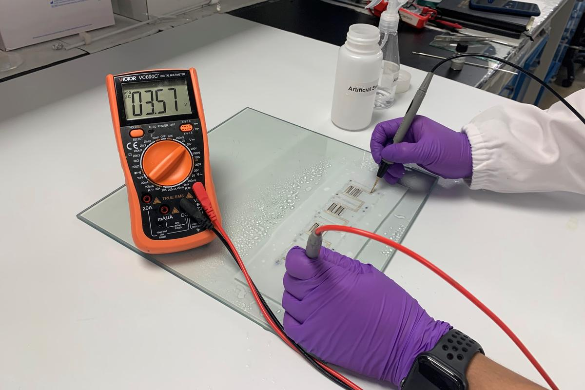 After being sprayed with artificial sweat, a strip of the batteries generated 3.57 volts of electricity
