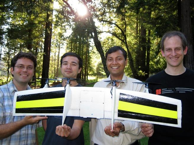 The Quadshot team and one of their prototypes