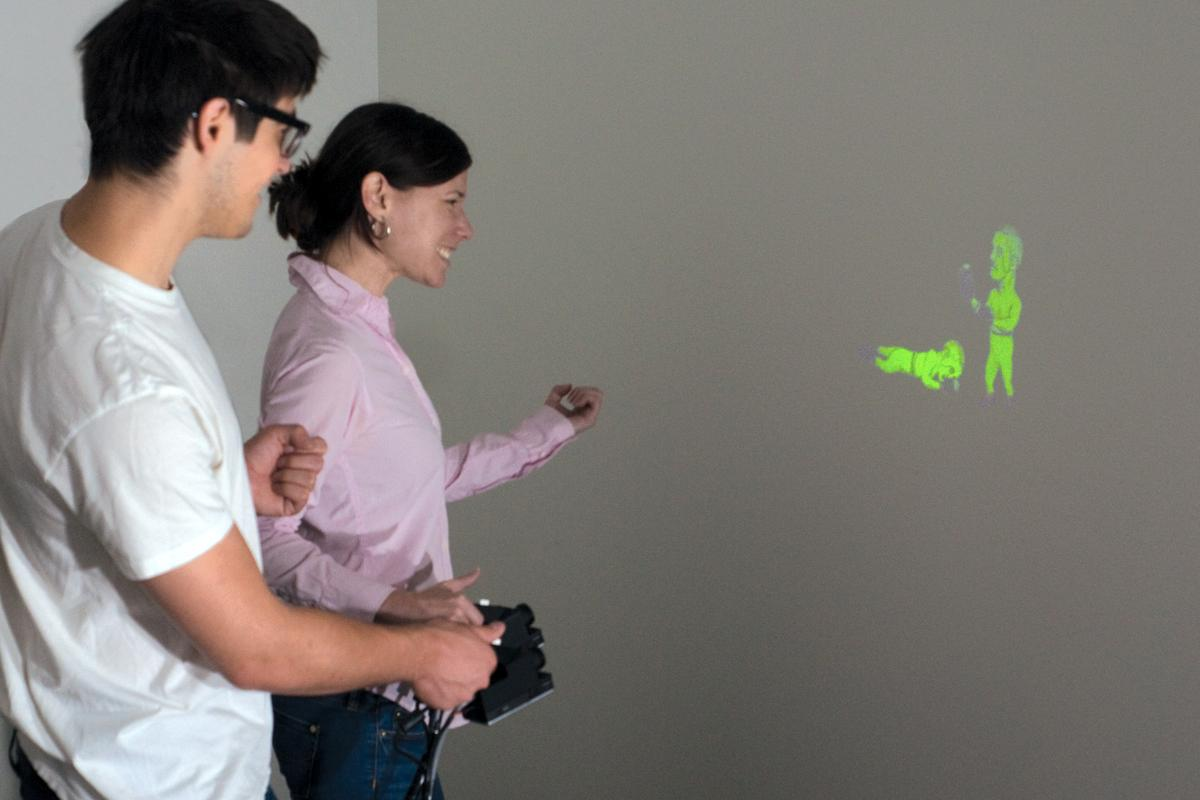 The prototype SidebySide system allows animated images from two separate pico projectors to interact with one another (Photo: Disney Research)