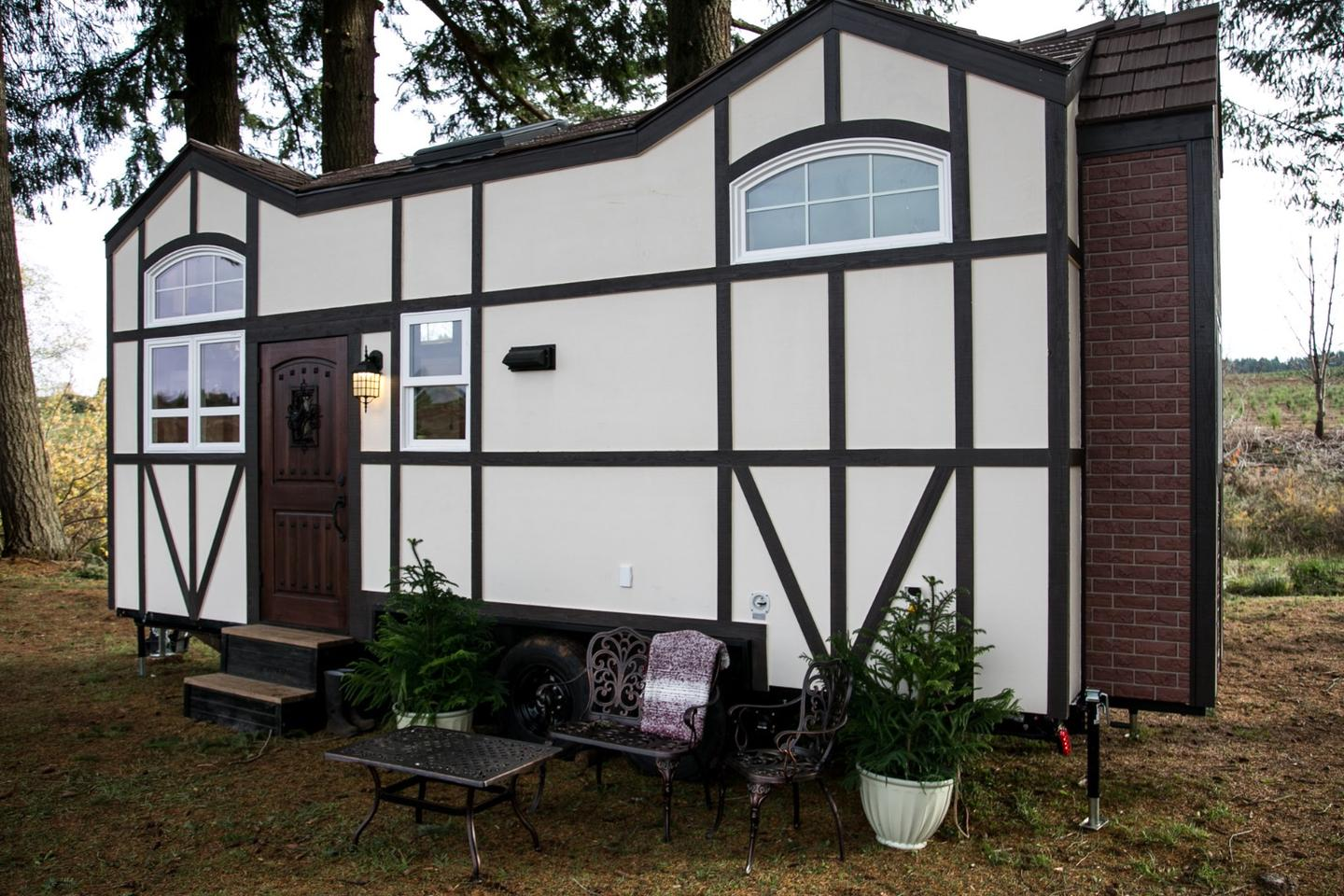 The Tudor-style tiny house measures 24 ft (7.3 m)-long, 8.6 ft (2.6 m)-wide and reaches a maximum height of 13.6 ft (4 m)