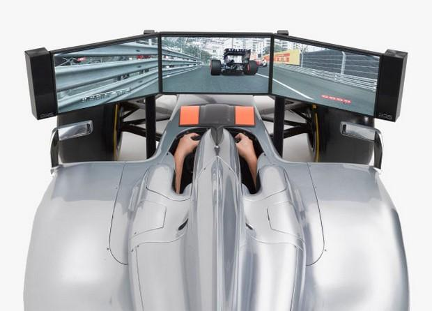 Drivers navigate courses via three 23 inch TFT Screens (8ms) mounted up front and driven by a seriously tricked out PC