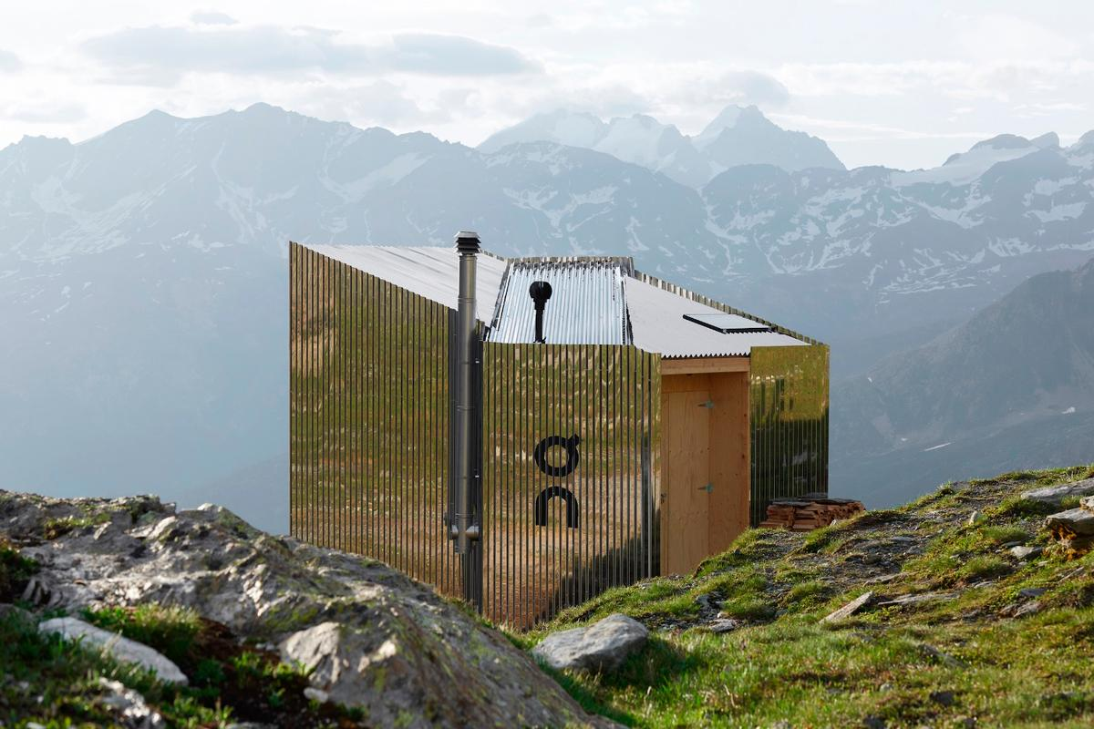 The On Mountain Hut runs off-the-grid, with roof-based solar panels providing power for the interior lighting