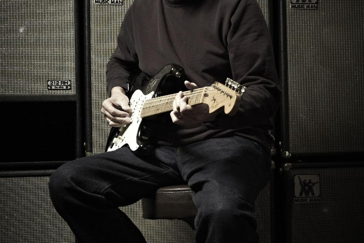 Eric Clapton with a signed 2006 'Blackie' recreation Stratocaster, estimated at between US$20,000 and US$30,000 (Credit: Original photo by Jack English, Marshbrook Limited 2010)